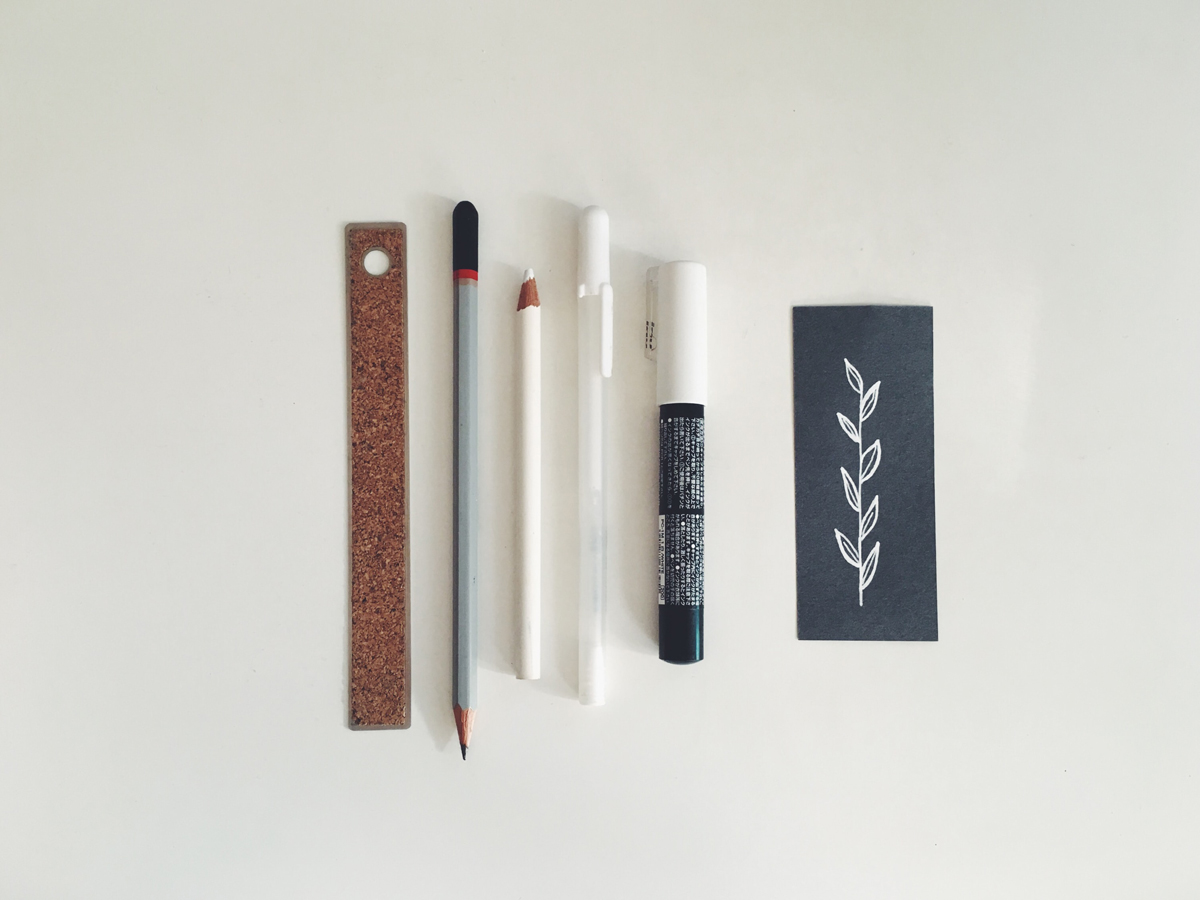 Writing utensils and ruler arranged side by side