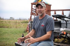 Doug Jarman sits on the bed of his truck and talks about the history behind the mud bog pit in Farwell, Mich. on Friday Oct. 4, 2013.