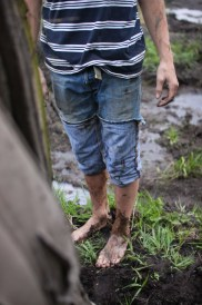 Logan Douglas, stands barefoot next to his truck in Farwell, Mich. on Friday Oct. 4, 2013.