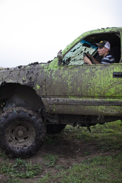 Logan Douglas, age 16, turns around to get a better angle before going through a mud pit Farwell, Mich. on Friday Oct. 4, 2013.