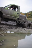 Logan Douglas, age 16, sits stuff in a pit of mud in Farwell, Mich. on Friday Oct. 4, 2013.