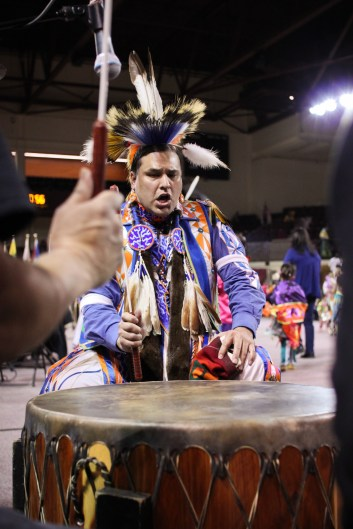 Kalamazoo resident Paul Syrette drums with his group the Southern Straits, the only southern style drum group at the 25th Annual Celebrating Life Pow Wow in McGuirk Arena Sunday, March 23, 2014.
