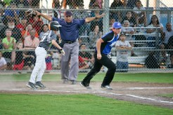 Jordan Wehlman, on the AAA Concrete team, slid safely into home plate in the first inning of the Semi Final Championship on the Roy High Field at the Victoria Youth Sports Complex.