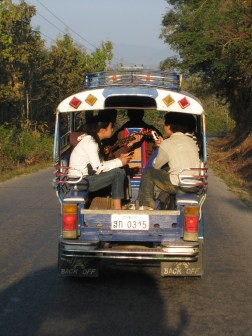 playing guitar in a tuk tuk in laos