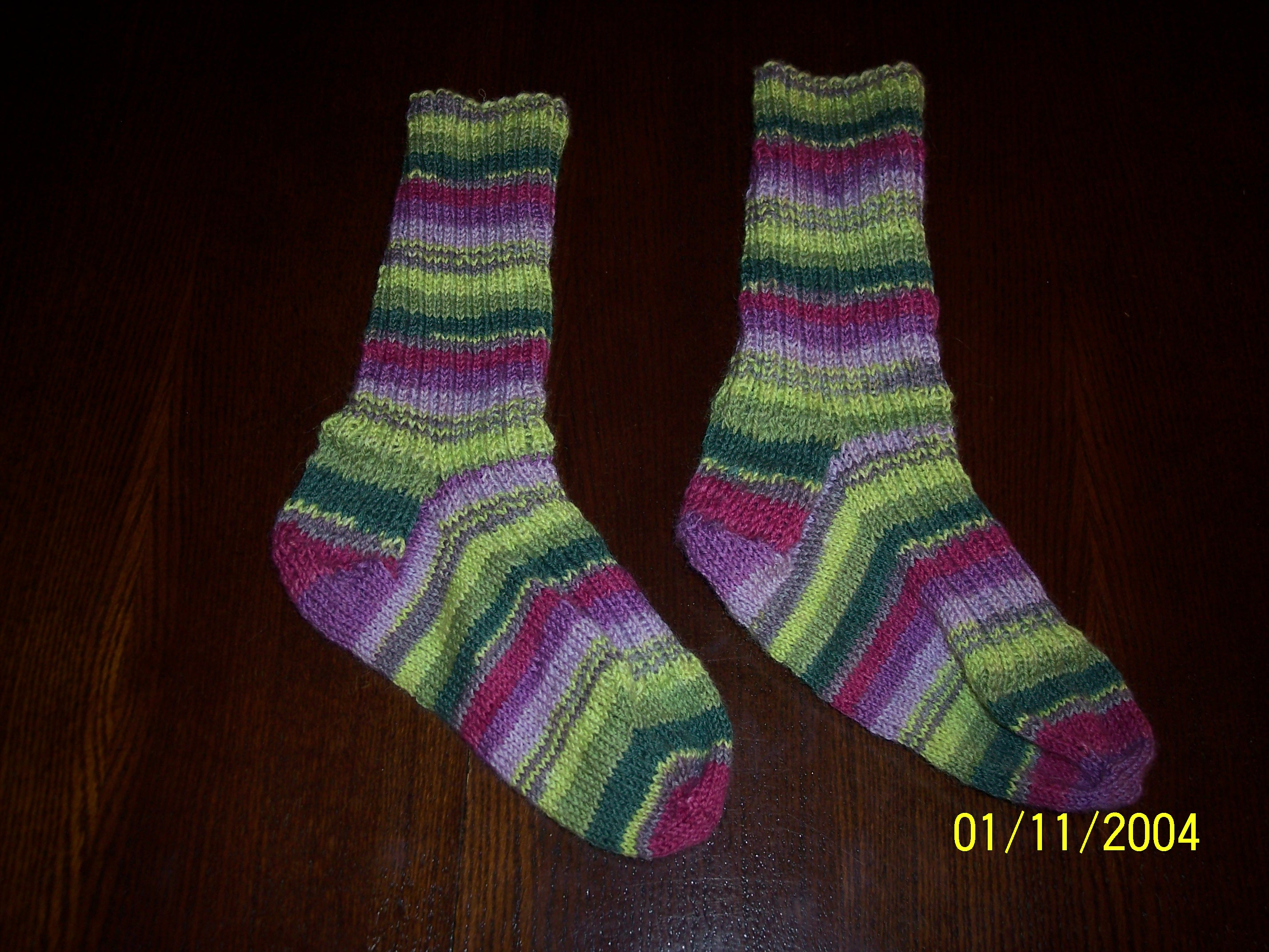 Finished socks--not quite even, but pretty nonetheless!