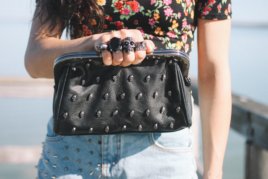 Skull studded knuckle duster clutch.