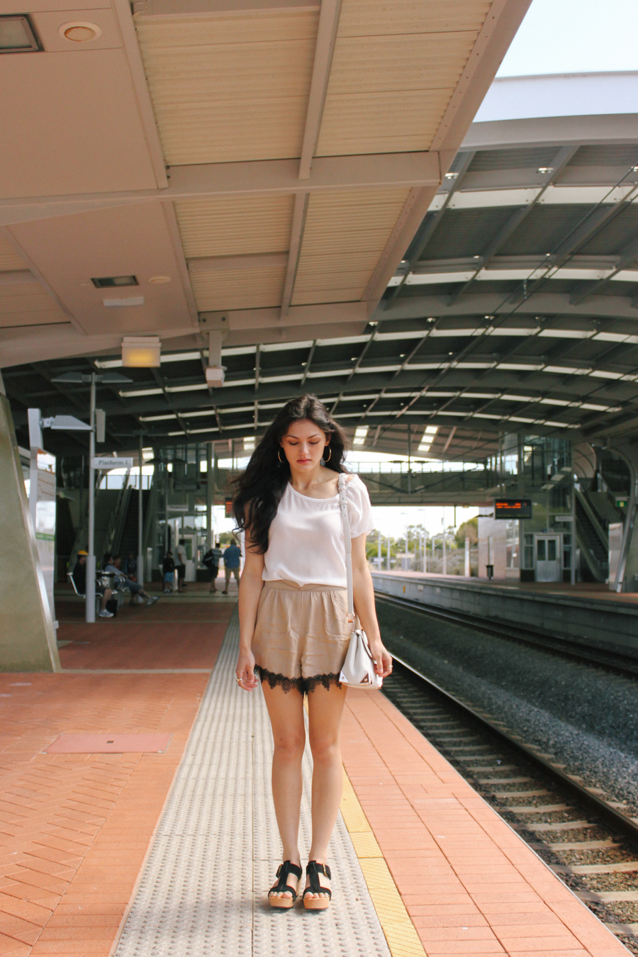 White silk top with lace trim shorts & platform sandals.