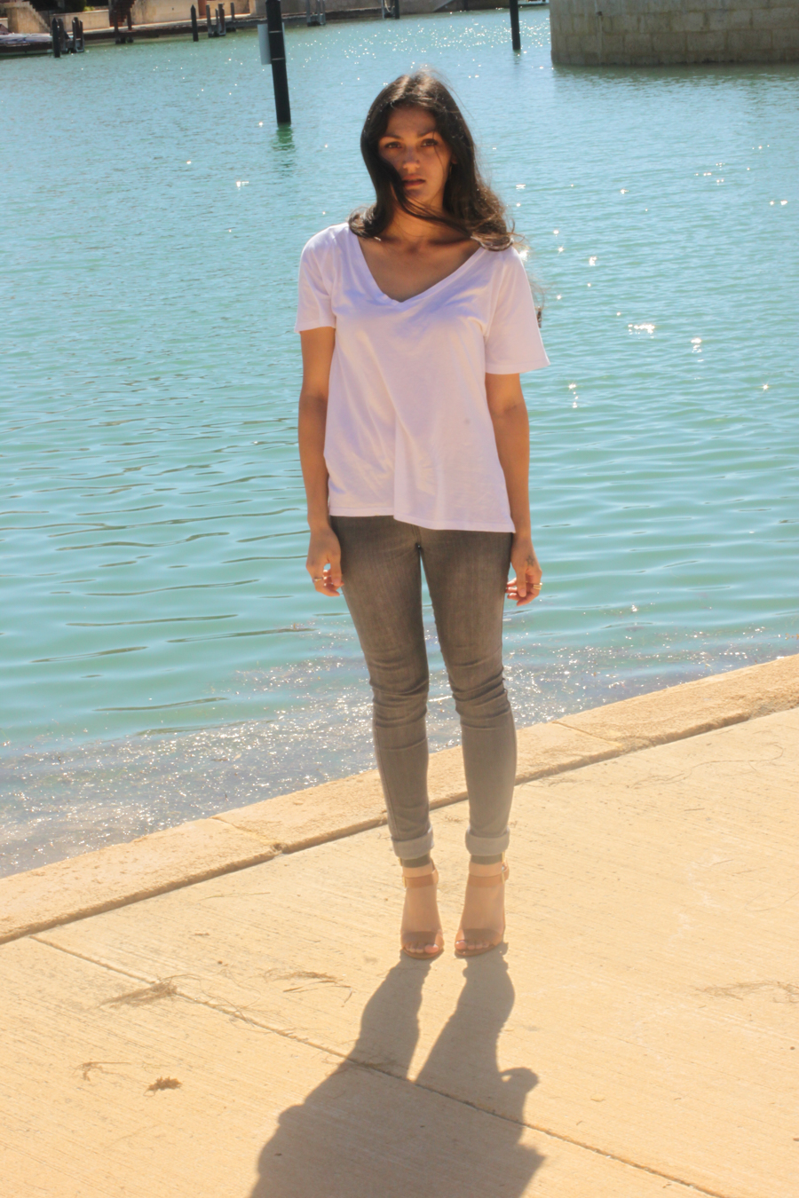 White v-neck top with jeggings.