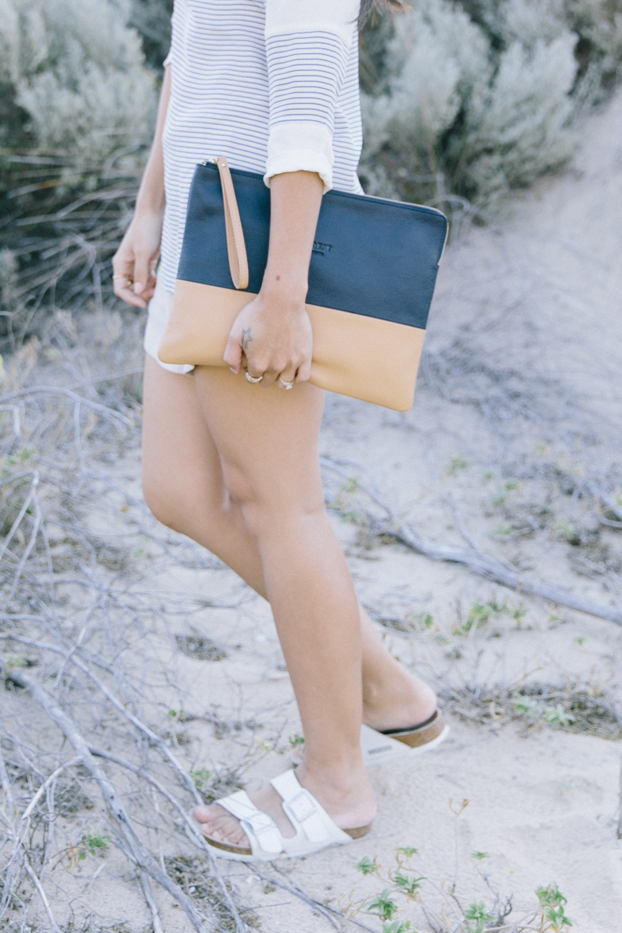 Leather two tone clutch. White Birkenstocks outfit.