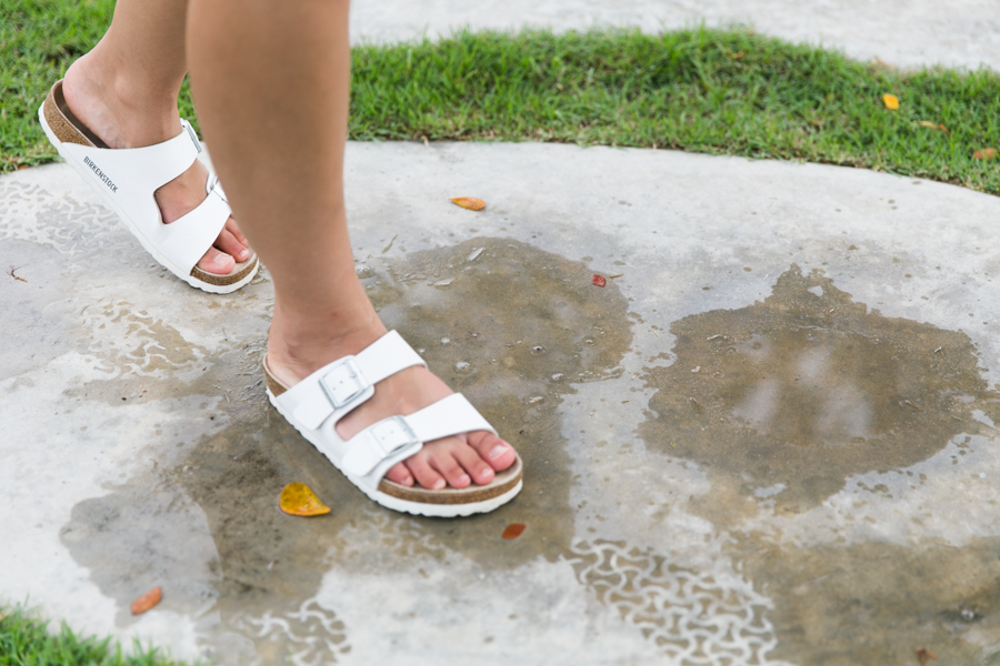 White Birkenstock Arizona sandals.