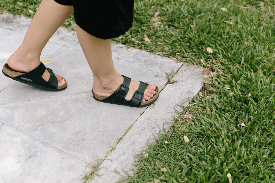 Black Birkenstock Arizona sandals with black culotte pants.