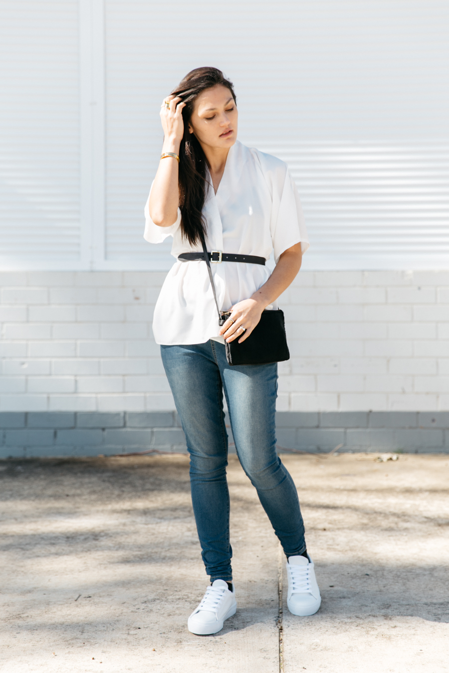 ASOS blogger collaboration: Match Yo Mama, wearing all ASOS: white wrap top, stretch jeggings, white sneakers.