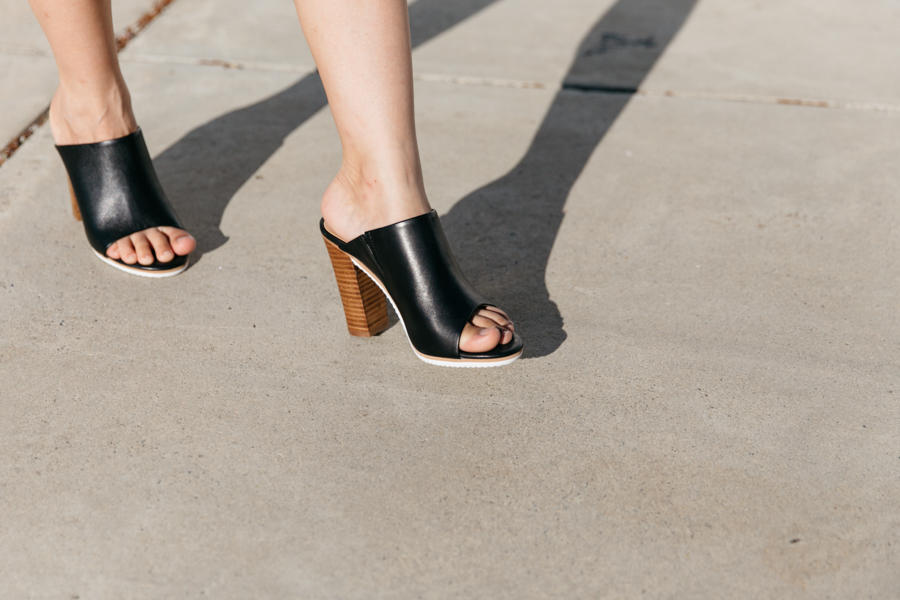 Black mules with wooden heel.
