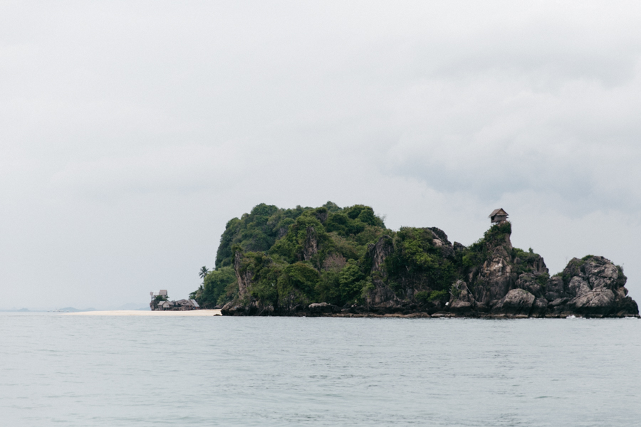 A secluded island in Thailand with white sand.