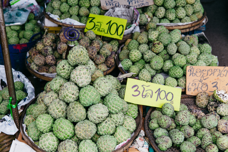 Custard apple being sold in a roadside stall in Thailand.