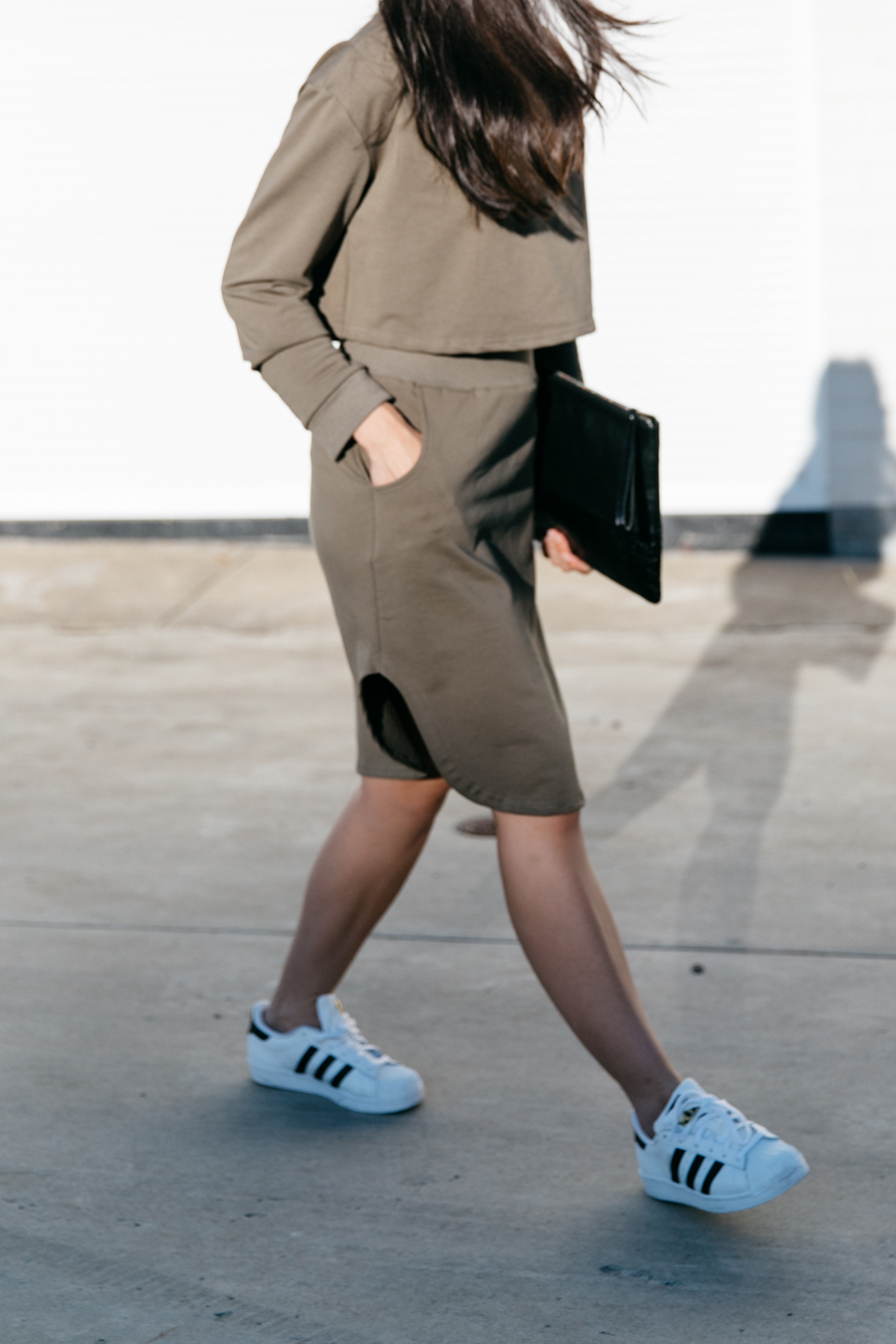 Adidas superstar sneakers & khaki skirt.