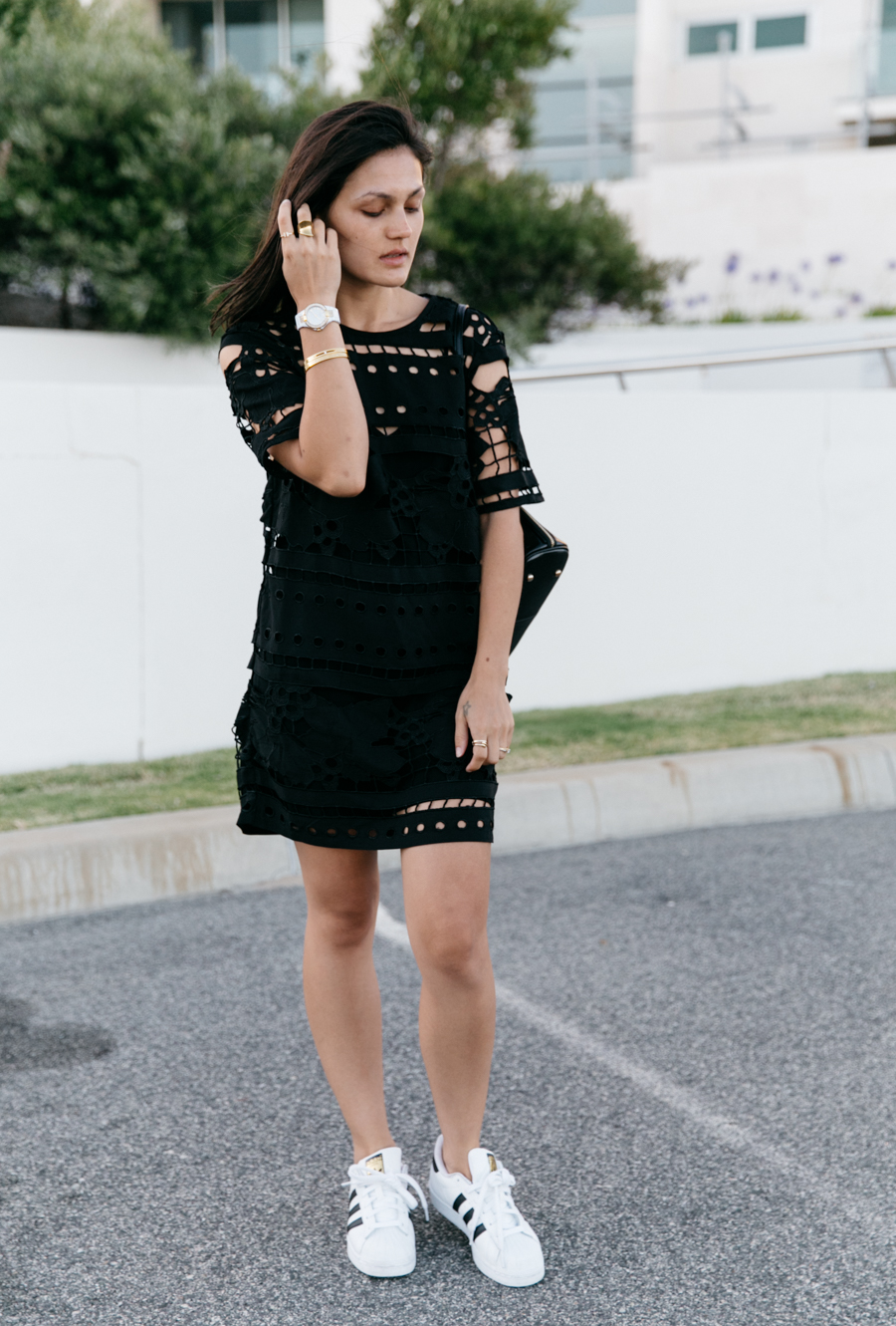 Casual style lace dress with Adidas sneakers.