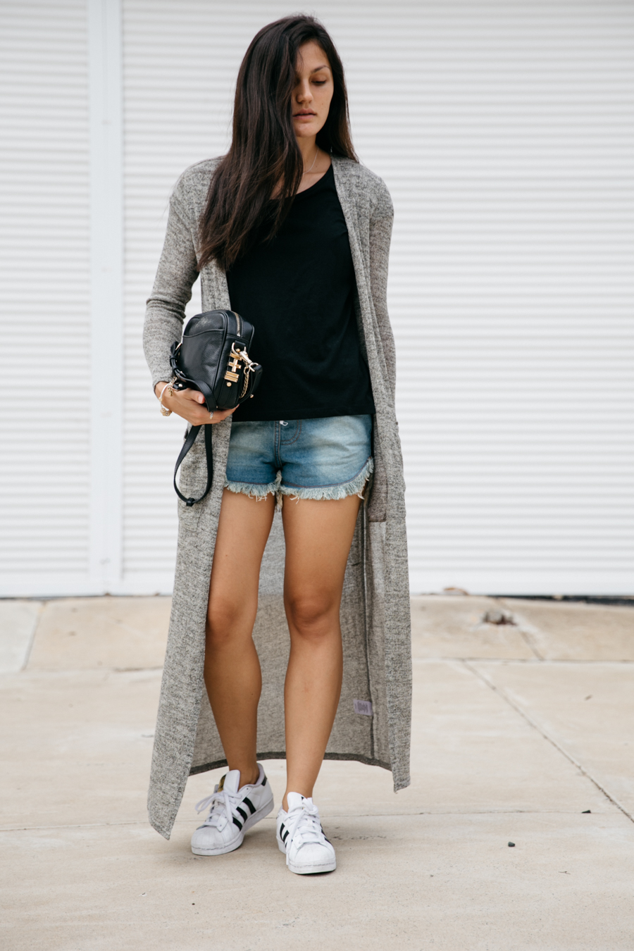 Long cardigan worn with denim cut offs & sneakers.