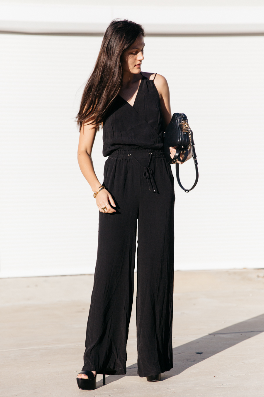 Black jumpsuit one piece with heels.
