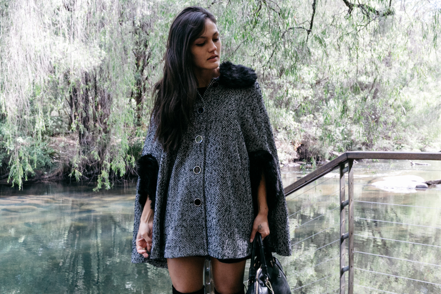 Monochrome cape with faux-fur trim.