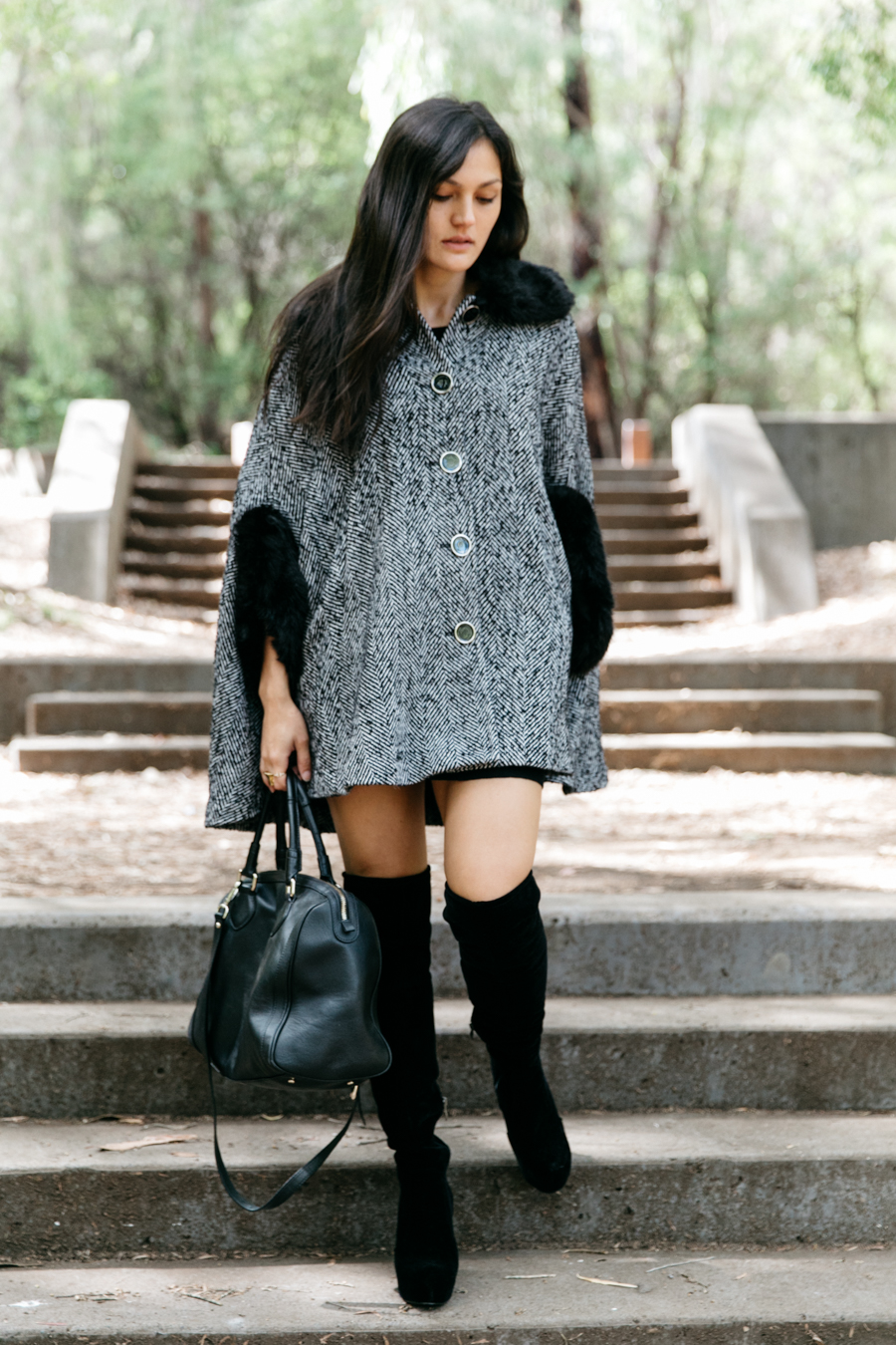 Fur cape with over the knee boots.