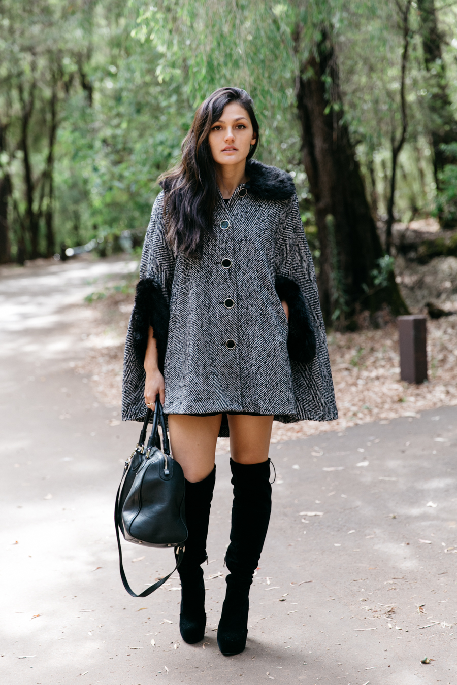 Review fashion fur cape with knee high boots.
