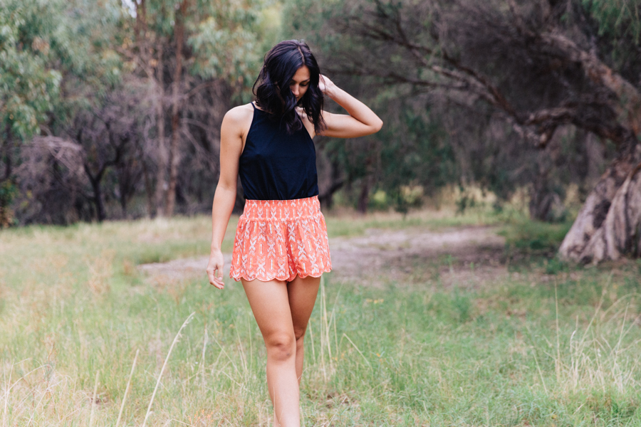 Orange scalloped shorts.