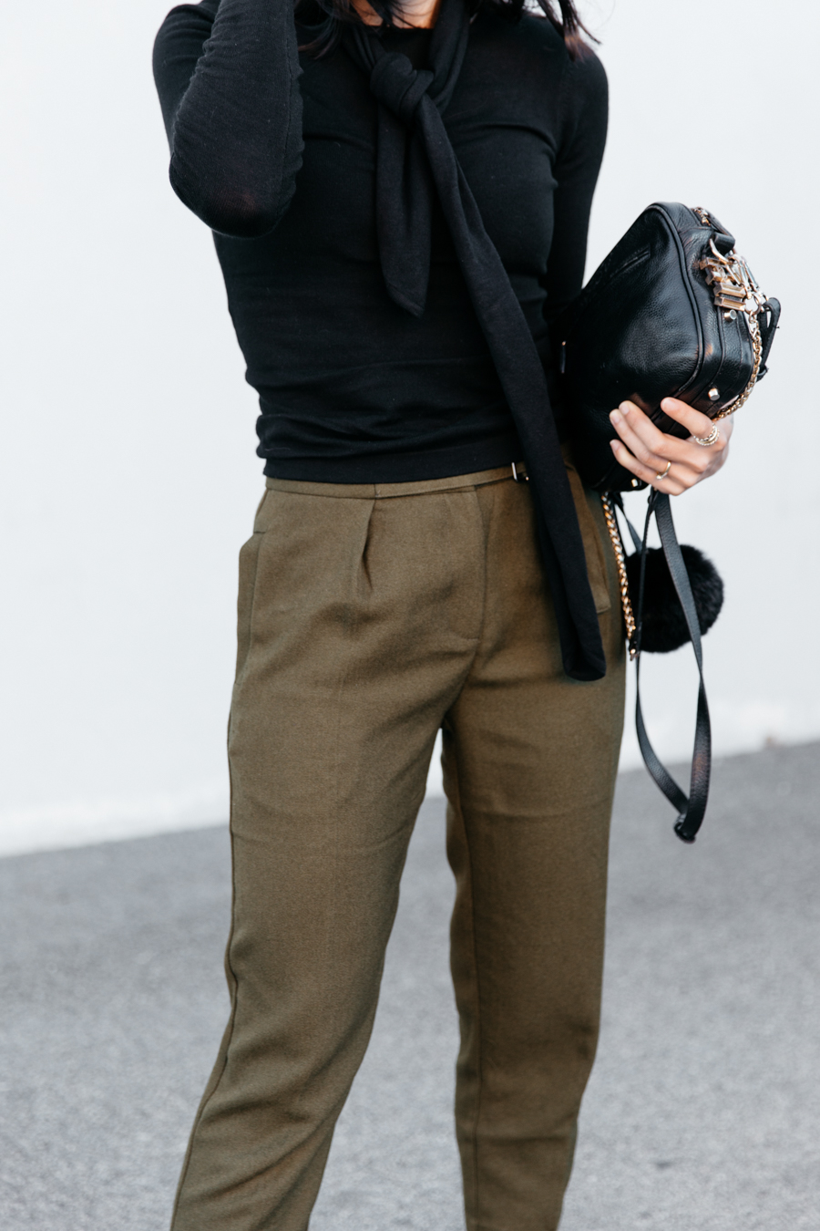 Khaki buckled crop pants. Khaki trousers.