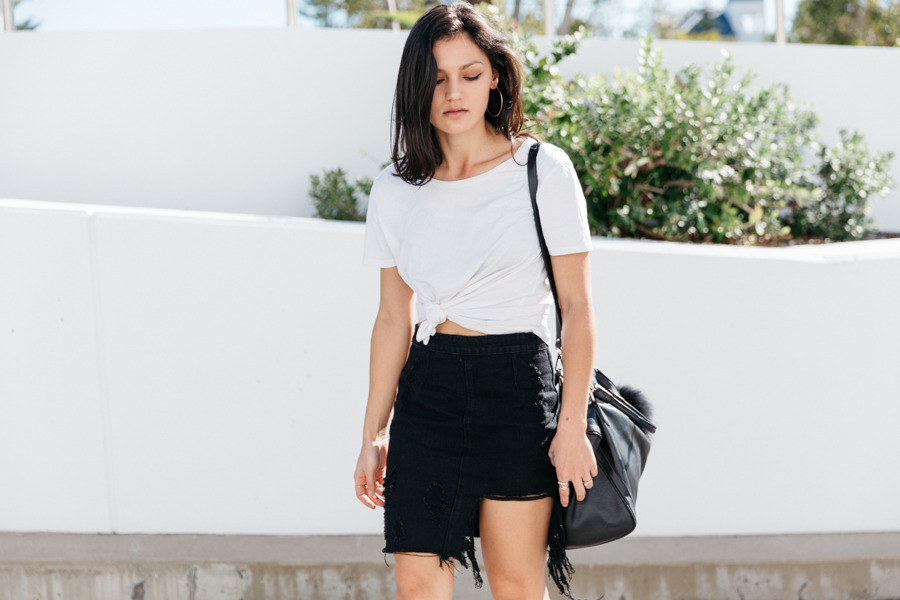 White knot tee with black denim skirt outfit.