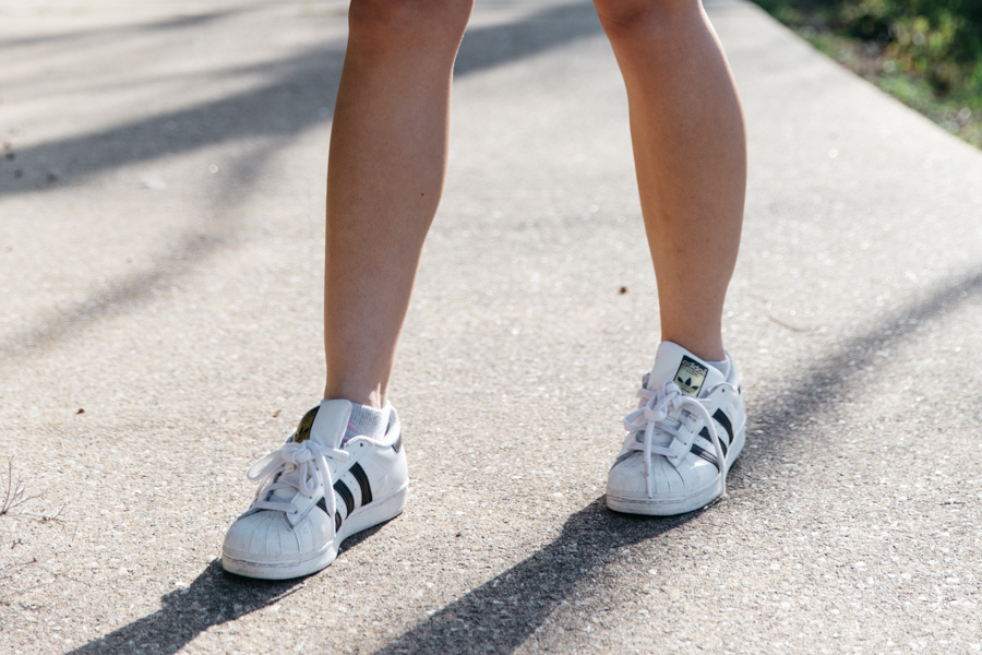 Adidas Superstar sneakers with dress outfit.