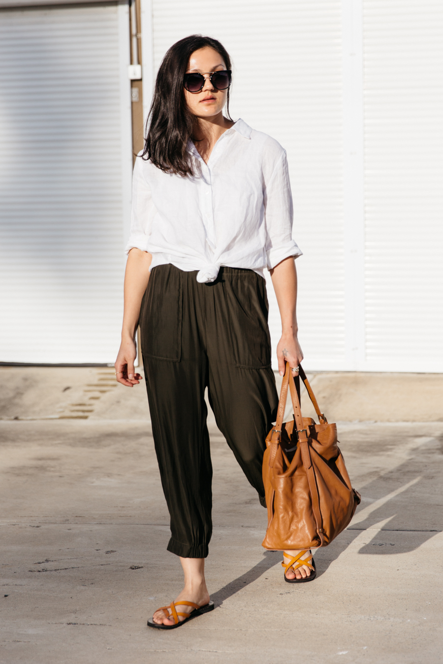 Silk pants in army green by Layer'd.