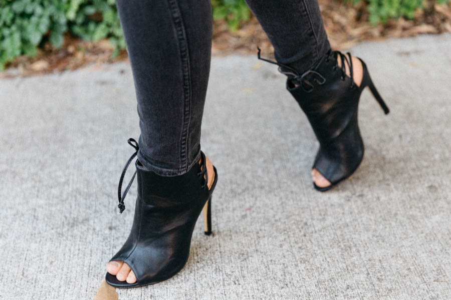 Lace back black leather booties. Black stiletto boots.