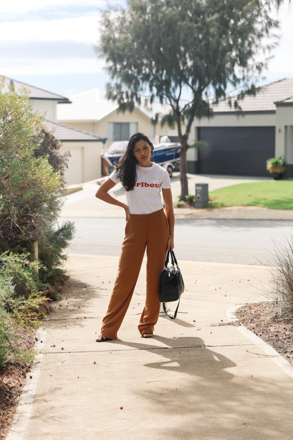Brown wide leg pants outfit with white slogan tee.