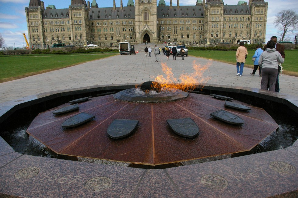 The flame with the Parliament Buildings behind it