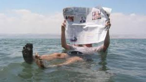 MAN READING NEWSPAPER IN DEAD SEA- CHAPTER 5 WATER, CLASS VII