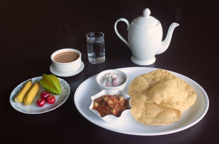 Batura, Bhatura, Batoora, Pathora, Bhatoora with Chole or Chola with a hot cup of tea at Sharanyam Homestay