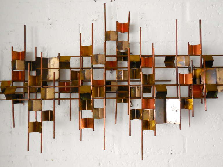 A Vintage Modernist Mixed Metal Wall Sculpture By William