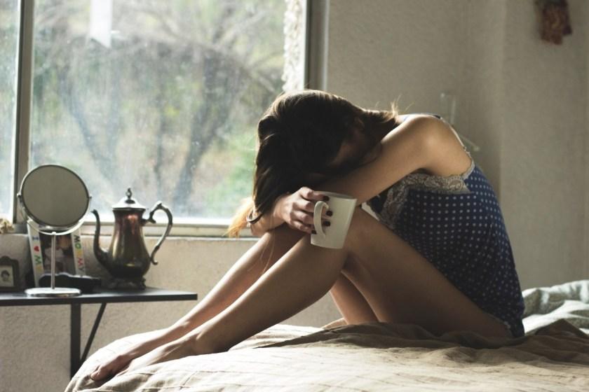 woman bed sad