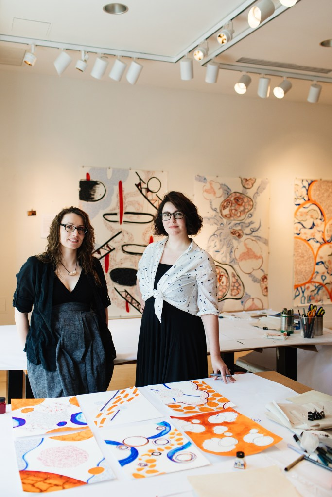 Maria and Fiona hanging artwork inside the Taplin gallery, 2017