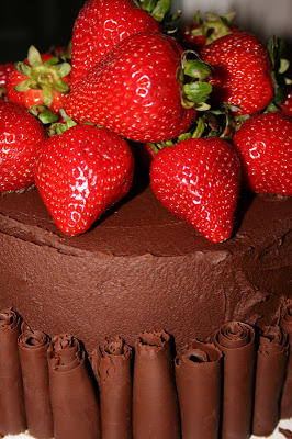 Chocolate Ganache Cake with Raspberry Filling... and Some Strawberries on Top.