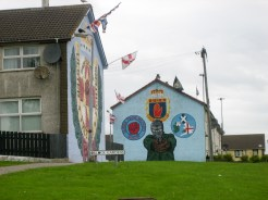 Flags on murals of the Ulster Defence Association (UDA). (c) Gordon GILLESPIE