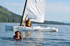 Family Sailing - Two boats and one boy in the lake