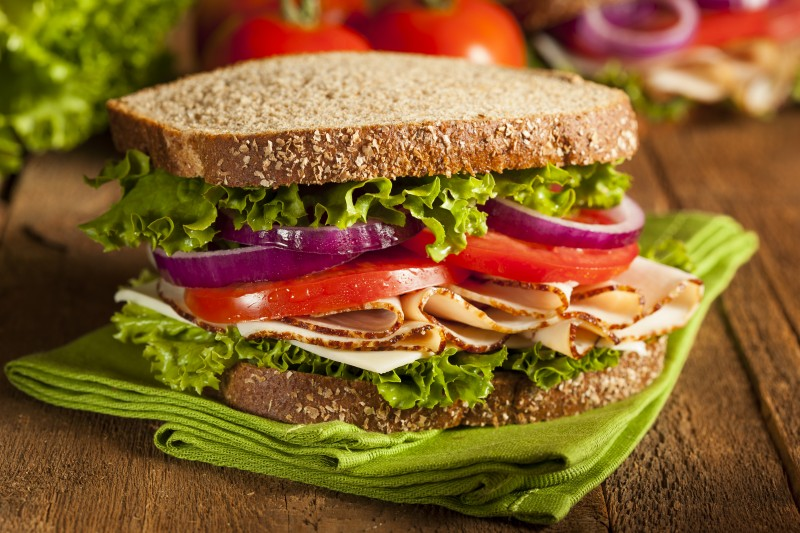 Homemade Turkey Sandwich with Lettuce, Tomato, and Onion