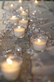 Tip: Never line up votives in a row, have them undulate along the rhinestone ribbon.