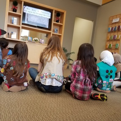 Girl Scouts earning a badge