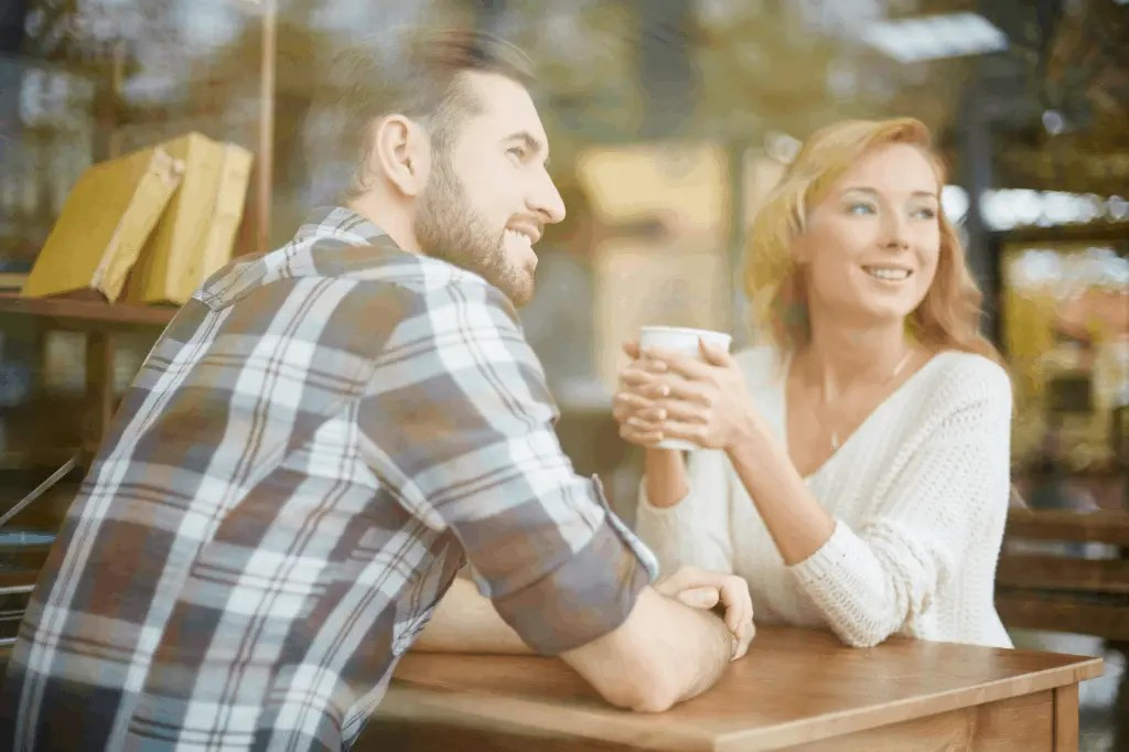 A man and woman talking over a cup of coffee