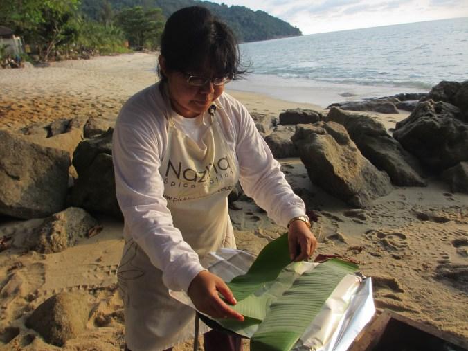 Nazlina Preparing Fish for Grilling