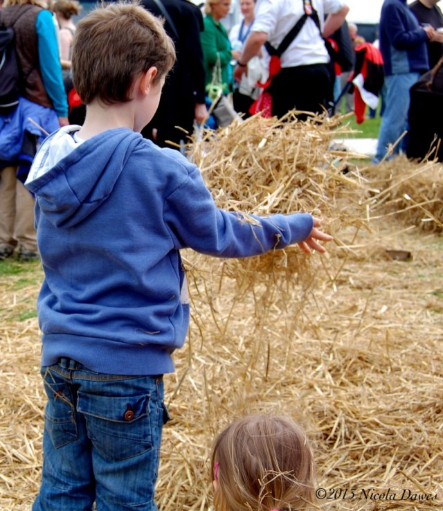 sharingourfoodadventures.com Archie having fun in the straw.