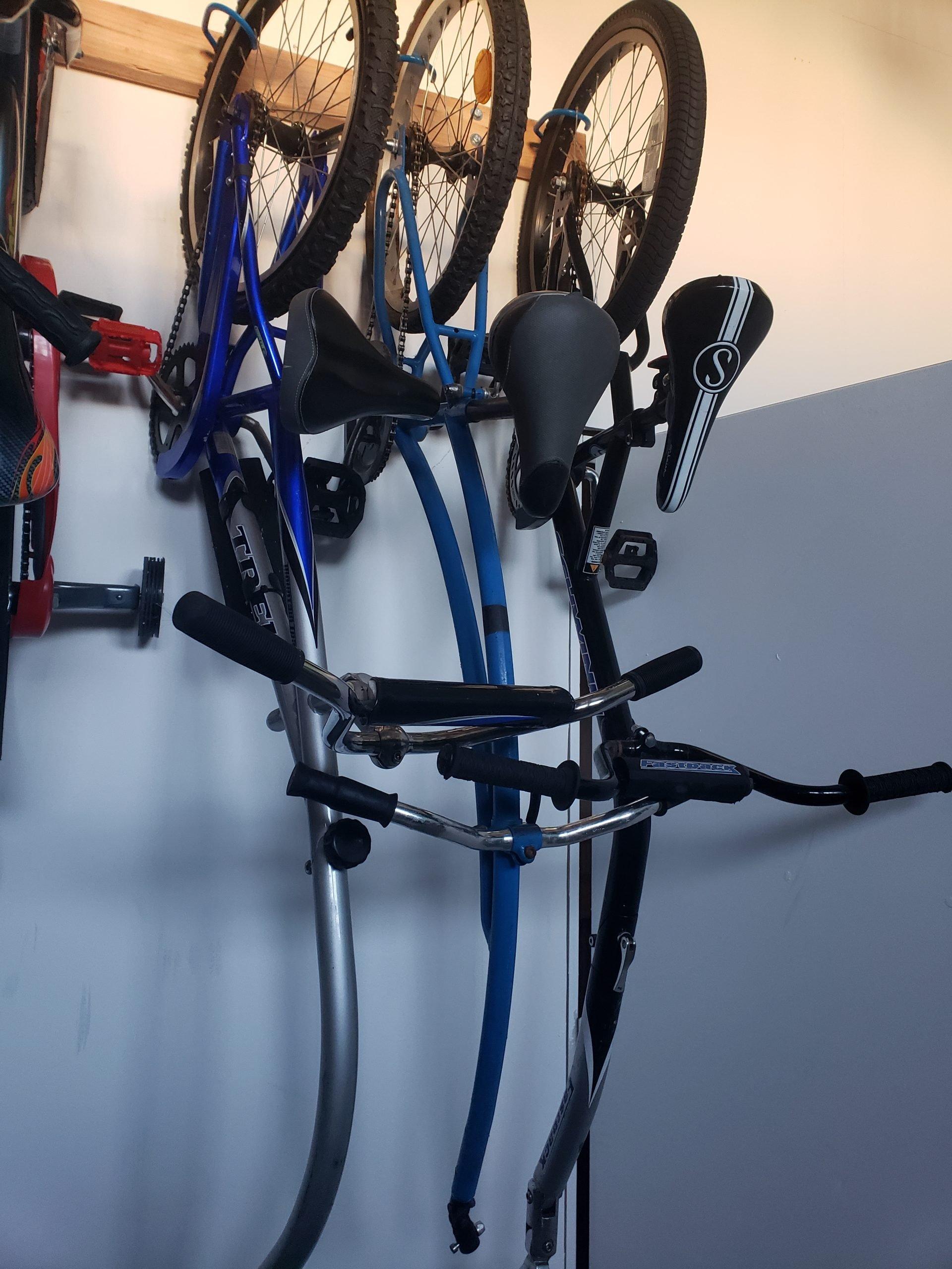 three one-wheeled bike attachments