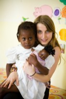Founder of Dominino, Tabea with one of the children from the school.